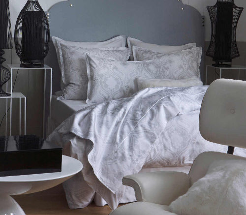 Alexandre Turpault Namaste duvet and sham collection in soft neutral tones.