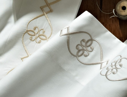 Peacock Alley Concerto pillowcases and flat sheet are embroidered in a continuous heart pattern.