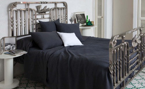Signoria Olivia coverlet and shams render a casual but elegant look.