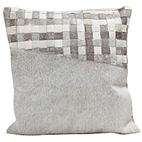 Fibre by Auskin decorative cowhide pillow stitched with contrasting sections offset with a large section of cowhide help create a beautiful illumination.