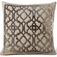 Decorative cowhide pillow by Fibre by Auskin is adorned with a lattice design.
