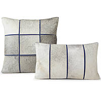 Decorative cowhide pillow by Fibre by Auskin with blue seperation lines with white pepper background.
