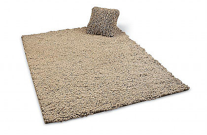 Fibre by Peacock Alley Pebble collection includes a rug and pillow.