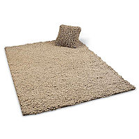 Peacock Alley Pebble collection includes a rug and pillow.
