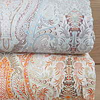 Bellino Paisley Quilted Coverlet and Shams is produced with linear quilted stitching over multi-colored paisley pattern.