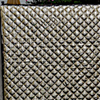 Metallic gold or silver chevron quilt with diamond quilting and matching shams.