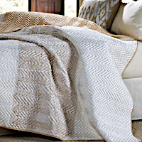 Ivory quilt with beige cut out chevron pattern and matching standard shams