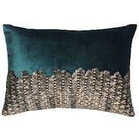 Velvet pillows with gold beadwork.