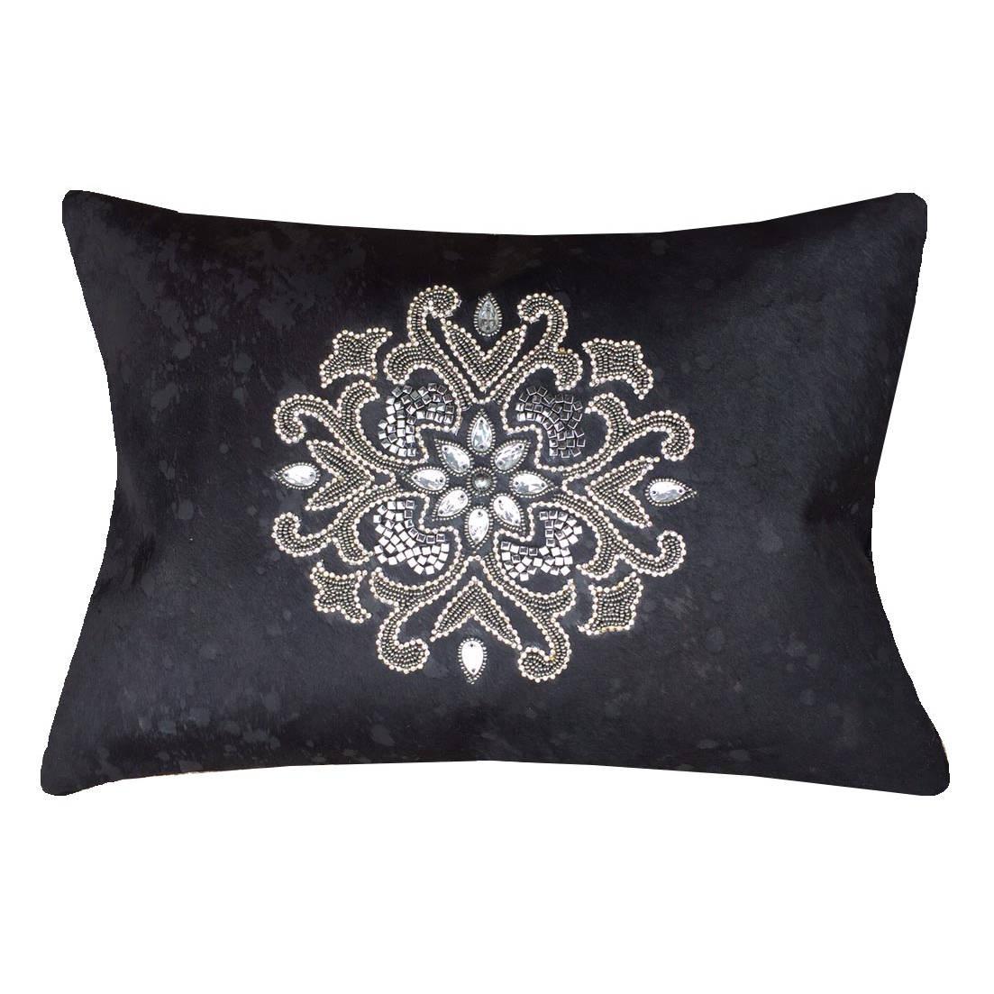 Decorative pillows hairon hide acid wash creations.
