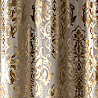 Light brown velvet drapery panel with gold embroidery.