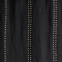 Charcoal jute drapery panel with silver metal studs.