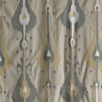Linen drapery panel with grey and gold ikat embroidery pattern.