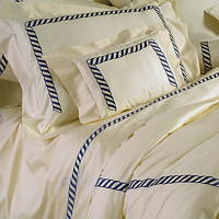 Custom embroidered bedding collection in 450 TC Egyptian cotton sateen. Made in Italy.
