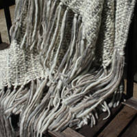Couture Dreams Cozi Knit Throw is just that...cozy! Adored with super chunky fringe making it funky, fun and unique. The neutral colors combined with the knit texture adds a breathtaking element to any room.