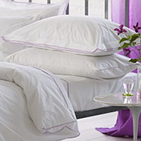 A stylish double Oxford embroidered edge in crocus purple gives this divine white luxurious 400 thread count cotton bedding a modern tailored feel.