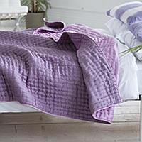 Luxuriously soft and lightweight 100% silk quilts and shams in damson purple with a reverse of magenta pink.