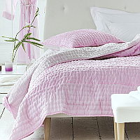 Luxuriously soft and lightweight 100% silk quilts and shams in a delicate peony with a reverse of soft pink.