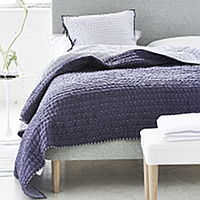 Luxuriously soft and lightweight 100% silk quilts and shams in a delicate plum with a reverse of amethyst.