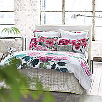Luxuriously soft and lightweight 100% silk quilts and shams in a delicate willow green with a reverse of silver.e.e.