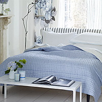 Luxuriously soft and lightweight 100% silk quilts and shams in a delicate sky blue with a reverse of chalk white. Hand-quilted and finished with a contrast cross stitch detail makes for a sophisticated complement to any bedroom.