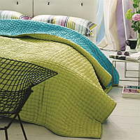 Luxuriously soft and lightweight 100% silk quilts and shams in a bright pistachio green with a reverse of turquoise.