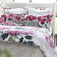 A painterly rose branch creates a sophisticated floral bedding.