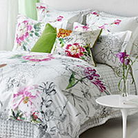 Beautifully painted botanical style tulips, peonies and garden flowers in fresh vibrant colors feature in this charming bedding design.