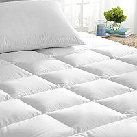 Enjoy an extra layer of comfort and protection with Downright Down Alternative Mattress Pad.