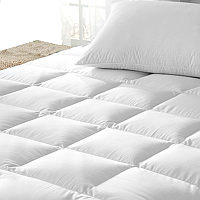 Indulge in the luxury of a down filled mattress topper by Downright.