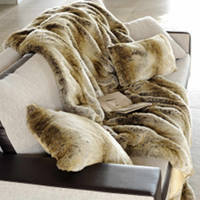Premium faux fur coverlets, bed throws, and decorative pillows in Monaco.