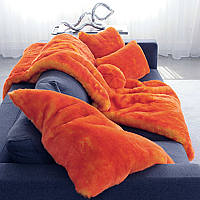 Evelyne Prelonge Couture Collection Faux Fur in Orange exhibits a beautiful luster.