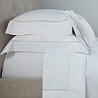 A 500 thread count, 100% Egyptian cotton Italian percale with an intricate crisscross embroidery design.