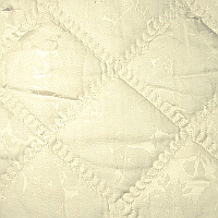 A 300 thread count Egyptian cotton rose pattern damask quilted with a scalloped edge finish for shams.