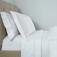 A lace inspired by Greek Doric architecture is applied to our 500 thread count Perla percale.