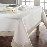 An elegant, 100% Italian linen table collection that is designed with a Doric lace inset and a contrasting linen cuff.