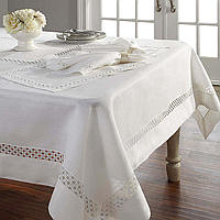 A 100% linen, finished with a square and lotus flower embroidery along the hem and in the center of the table cloth.