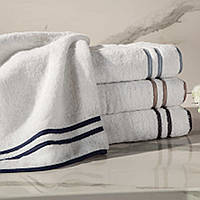 Izmir towel, a 550 gram, zero twist, 100% Egyptian cotton, Turkish terry, is finished with a pair of sateen ribbons and straight edge piping for a tailored look.