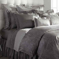 A 600 thread count, Italian jacquard fabric, available in Reptile and Geometric patterns.