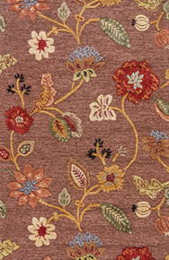 Classic florals in gold, green, red, and blue cover this hand-tufted area rug with traditional charm.