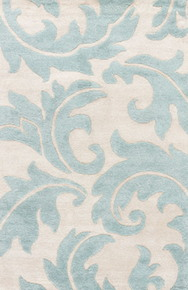 Elegant acanthus leaf flourishes cover this hand-tufted area rug with traditional charm.