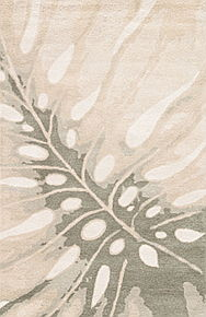 This hand-tufted wool area rug showcases a contemporary botanical design and serene coastal hues.