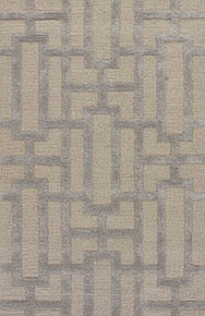 Large-scaled geometric patterning defines the contemporary style of this hand-tufted area rug.