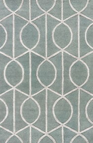 An eye-catching geometric pattern makes a graphic statement on this hand-tufted area rug.