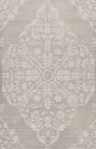 This stunning hand-knotted area rug showcases global-inspired style, captivating with a lustrous silver center medallion and scrolling details.