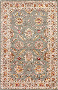 This hand-tufted area rug offers vintage elegance to traditional homes. Scrolling vines and floral medallions gracefully cover this classic wool layer in sage green, warm beige, and rusted red-brown.
