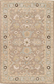 Timeless with an antique floral design, this hand-tufted wool rug boasts a classic pattern of scrolling vines and medallion-style blooms