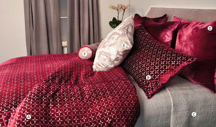 Kevin O'Brien Studio Metallic Petals Bedding includes a duvet, pillow shams, and decorative pillows.