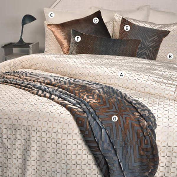 Kevin O'Brien Studio Metallic Petals Bedding includes a duvet, pillow shams, and decorative pillows.