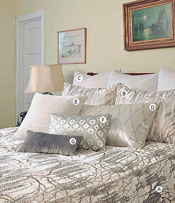 Kevin O'Brien Studio Metallic Willow Bedding includes a duvet, pillow shams, and decorative pillows.