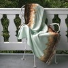 Kevin O'Brien Studio merino wool throws are available edged in silk/rayon velvet and embellished with velvet appliqu�.